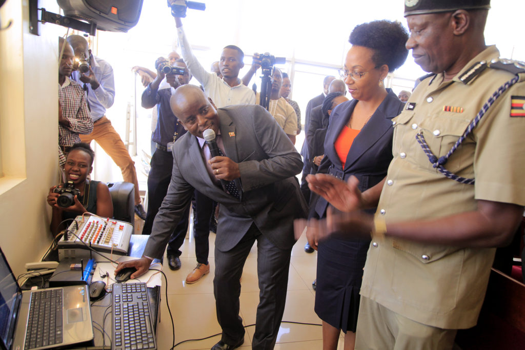 MINISTER OF STATE FOR PUBLIC SERVICE HON. DAVID KARUBANGA OFFICIALLY LAUNCHES THE DECENTRALIZATION PENSION AND GRATUITY MANAGEMENT AT POLICE HEADQUARTERS NAGURU ON 27TH FEBRUARY 2019