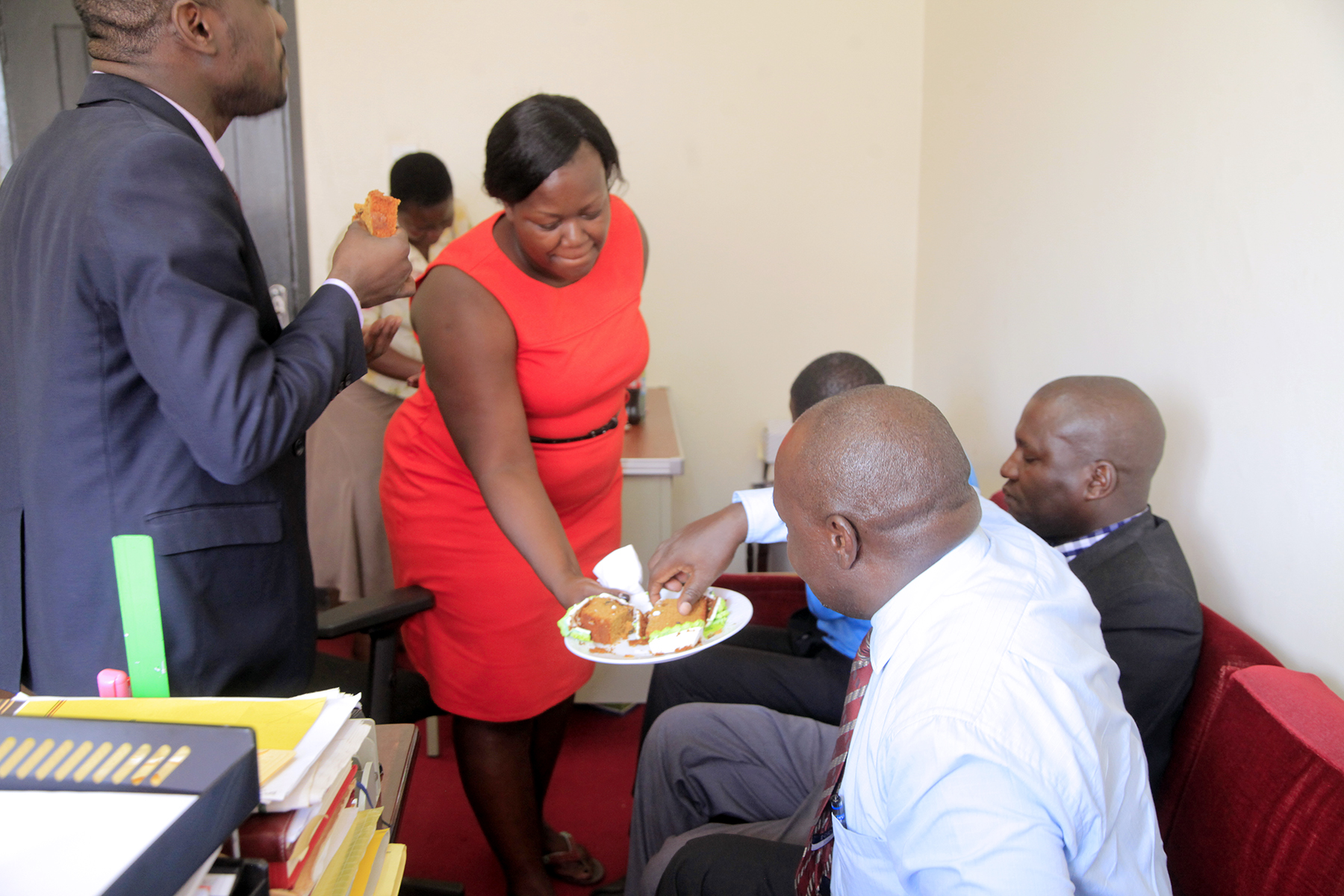 _MINISTRY STAFF THROW A BIRTH DAY PARTY TO SENIOR HUMAN RESOURCE OFFICER - ADMINISTRATION -ESTHER NAMANGHE