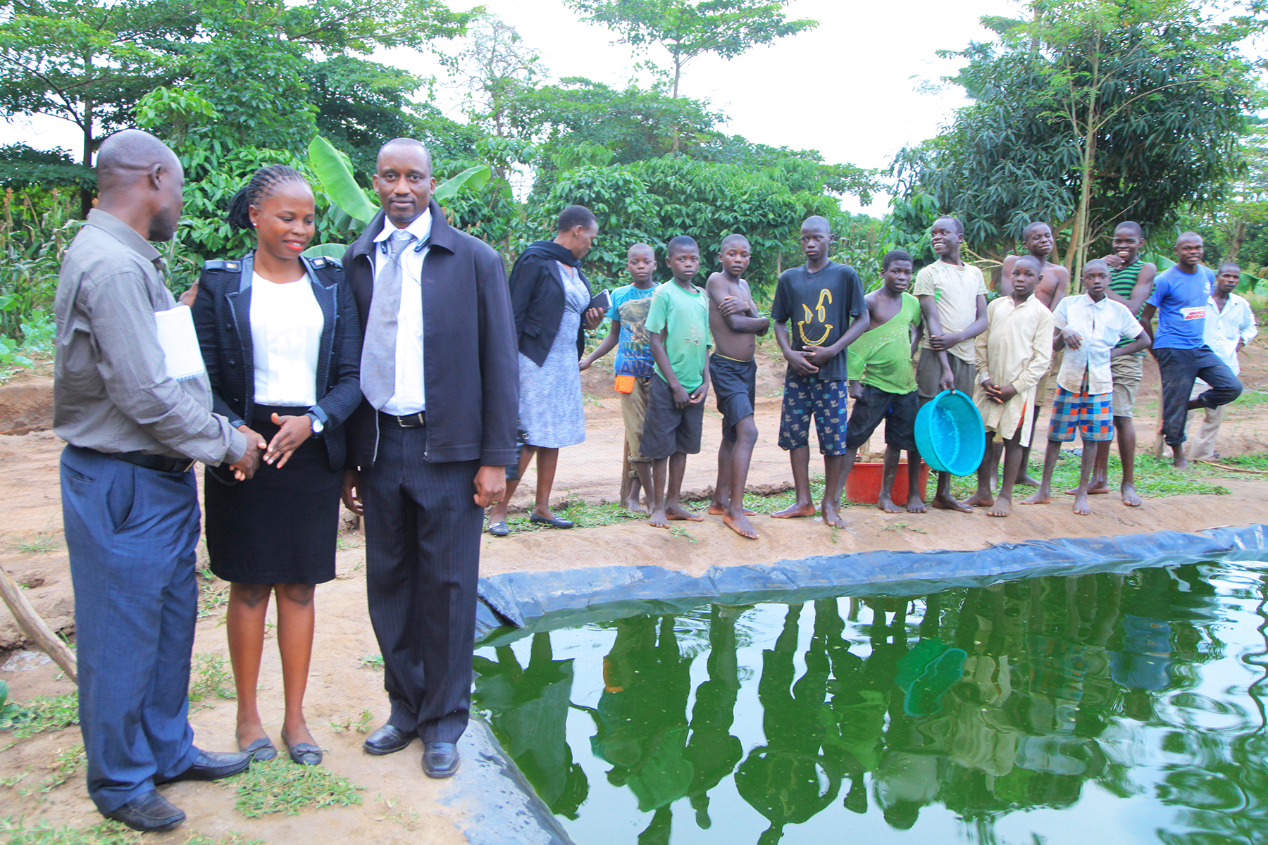 DamaliSHRO Namutumba district and Keneth Atim PPA Ministry of Public Service at the fish Pond recently.