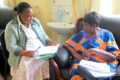 Dr Florence Tuguminssiriza attends to pensioner who formally worked at the faccility as a Nursing Officer