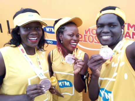 Participating ministry officials showing off their medals after completing the MTN marathon 2019