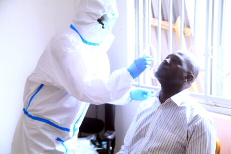 UNDER SECRERTARY DANIEL MUGULUSI GIVES AN EXAMPLE DDURING COVID-19 VIRUS TEST OF STAFF AT WANDEGEYA HEADQUARTERS OFFICES ON 14TH JULY 2020.